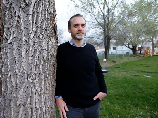 Nathan Frodsham, who suffers from cervical arthritis and disc disease, poses for a photograph at his home, Monday, April 16, 2018, in Murray, Utah.
