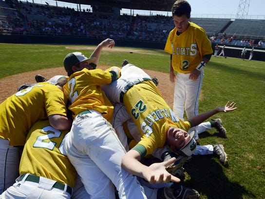 Edgewood pitcher Chase Laney (23) and teammates celebrate