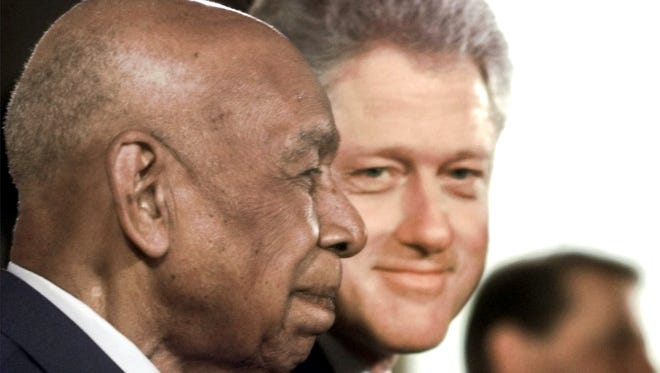Herman Shaw, 94, a Tuskegee Syphilis Study survivor, and President  Bill Clinton on May 16, 1997. Shaw died in 1999.