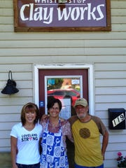 Whistle Stop Clay Works owners Kay Bolin-O'Grady and Tim O'Grady surround ceramic artist and teacher Bonnie McNett who will take over operations of the popular pottery business in Loveland Aug. 1