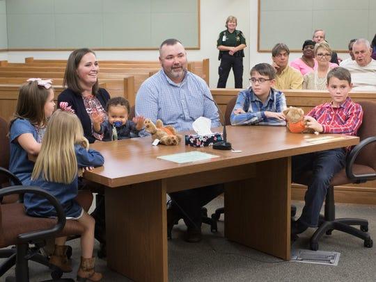 The Holland family formalizes the adoption of 1-year-old
