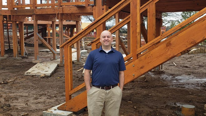 Kregg Clemens, who has been named general manager of The Clubhouse, visits the construction site Monday afternoon.