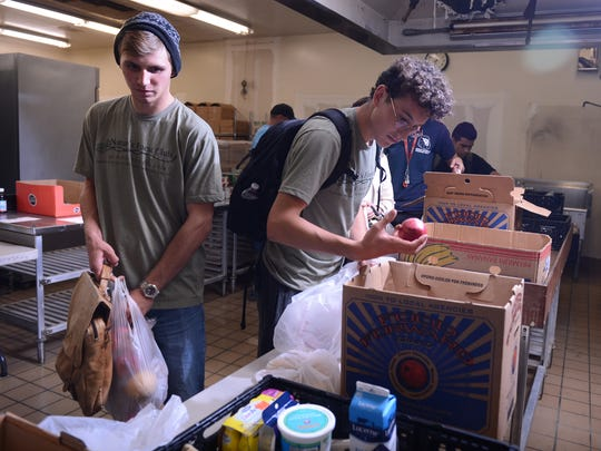 James Patterson (left) and fellow student Payton Robinson stop by the Ruben Castro Charities food pantry at Moorpark College on Tuesday evening.