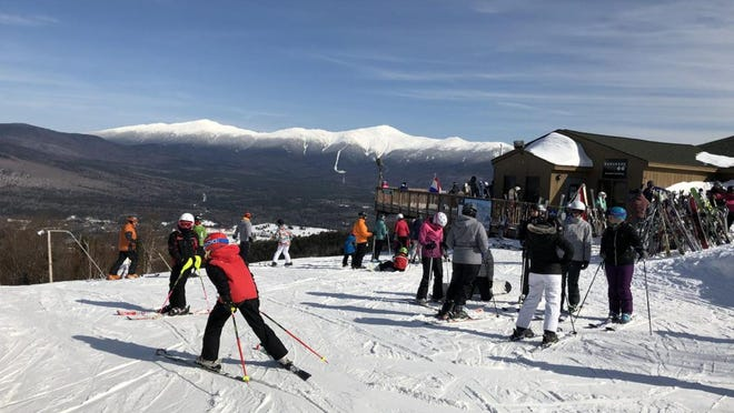 Skiers gather at Bretton Woods last February not long before COVID-19 shut down slopes across New Hampshire. Ski area officials presented a draft plan for opening this winter to the state.