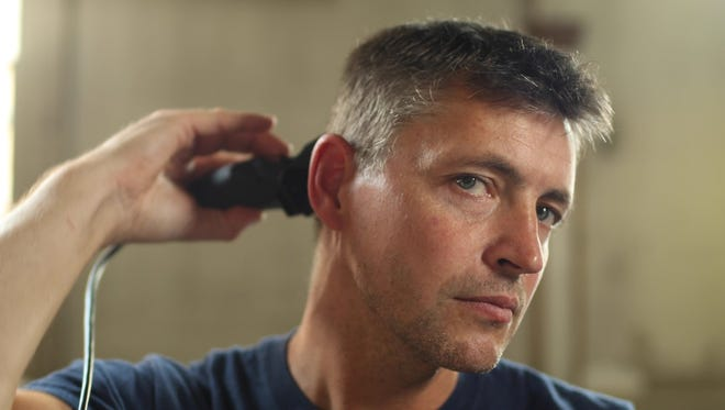 York City Firefighter Ivan Flanscha uses a Wahl hair clipper for a trim. Flanscha, along with several other city firefighters, are featured in a Wahl TV ad.