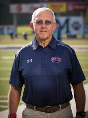 St. Thomas More head coach Jim Hightower has a career record of 376-116-1.