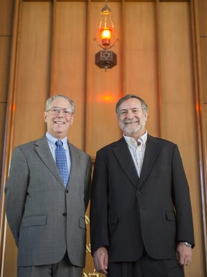 Rabbi Scott Kramer, right, and Rabbi Elliot Stevens stand inside the sanctuary at Agudath Israel Etz Ahayem Synagogue in Montgomery on Sept. 18, 2015. The two Montgomery rabbis are gearing up for Judaism's holiest time of year, which begins Sundaynight.
