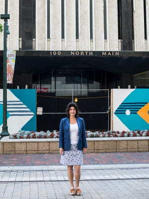 July 11, 2018 - Arlene Maidman, executive co-chair of the townhouse management company, stands outside of 100 North Main.