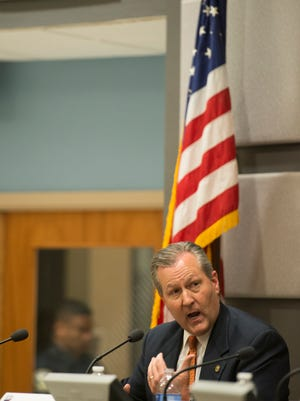 Alabama Speaker of the House Mike Hubbard answers a question at the League of Women Voters Political Forum on Monday, Oct. 20, 2014, in Auburn, Ala. Hubbard was indicted on 23 felony counts on Monday.