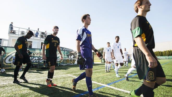 Vermont walks onto the field fro player introductions before the start of the men's soccer game between the UNC-Asheville Bulldogs and the Vermont Catamounts at Virtue Field on Friday afternoon September 11, 2015 in Burlington, Vermont. (BRIAN JENKINS/ for the FREE PRESS)