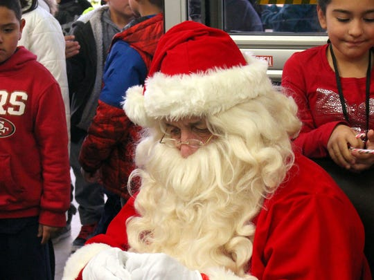 Santa Claus visited with each child during Saturday's
