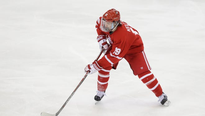 Boston University forward Clayton Keller controls the puck during the third period of an NCAA West Regional college hockey final against Minnesota-Duluth, Saturday, March 25, 2017, in Fargo, N.D.