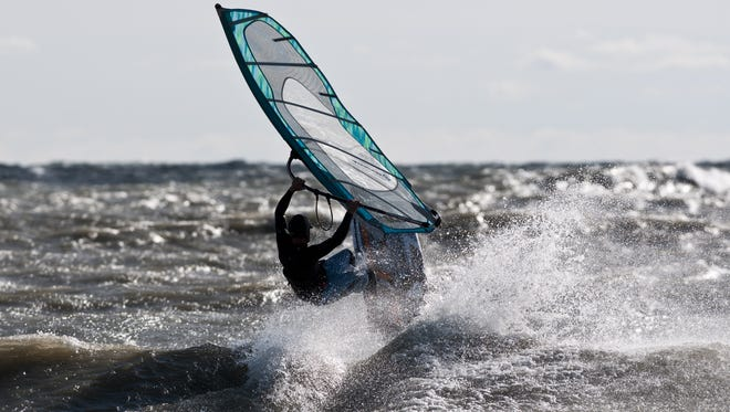 A wind surfer jumps a wave in Lake Huron. The National Weather Service is warning of gale force winds on the lake.