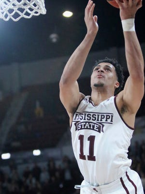 Mississippi State guard Quinndary Weatherspoon (11) scores near the end of the team's NCAA college basketball game against Florida, Tuesday, Jan. 15, 2019 in Starkville, Miss. Mississippi State won 71-68. (AP Photo/Jim Lytle)