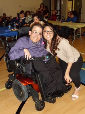 Angel View client Gregory Bryan and Eleanor Trinidad, president of the Interact Club, catch their breath between dances.