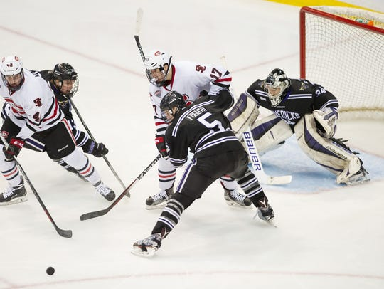 St. Cloud State's Blake Winiecki, far left, chases