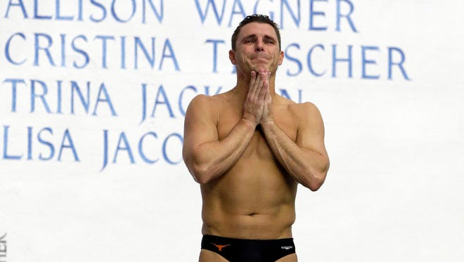 Troy Dumais reacts to the crowd as he waits to performs his final dive during the men's 3-meter springboard final at the U.S. Olympic diving trials in Indianapolis, Saturday, June 25, 2016. (AP Photo/Michael Conroy)