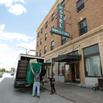 Movers help a family move out of the Missouri Hotel on Tuesday, April 21, 2015. The Kitchen Inc. has  moved shelter residents into more permanent housing throughout the city, part of a new strategy to end homelessness in Springfield.