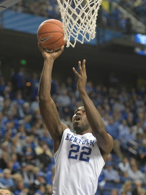 UK's Alex Poythress lays up the ball during the University of Kentucky mens basketball game against Eastern Kentucky University at Rupp Arena in Lexington, Ky., on Wednesday, December 9, 2015.