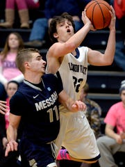 Messiah's Luke Cable, left, defends Lebanon Valley College's Zach Mrozek during a game in January. Cable, a West York graduate, recently put up a season-high 24 points in a loss to Eastern Mennonite.