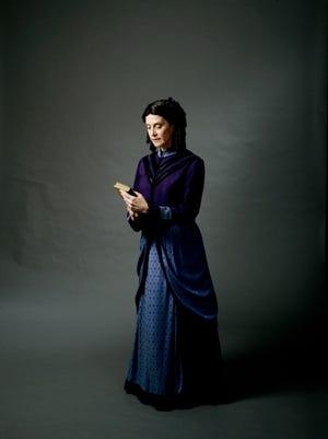 Elizabeth Davidson as Harriet Beecher Stowe.