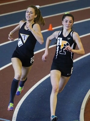 Tatnall's Keelin Hays (left) unleashes a final rally to edge Padua's Lydia Olivere by .03 of a second in the girls 1,600 meters at the DIAA Indoor Track and Field Championships in Landover, Md.