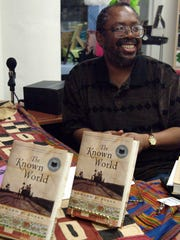 Author Edward Jones pauses for a photo during a book