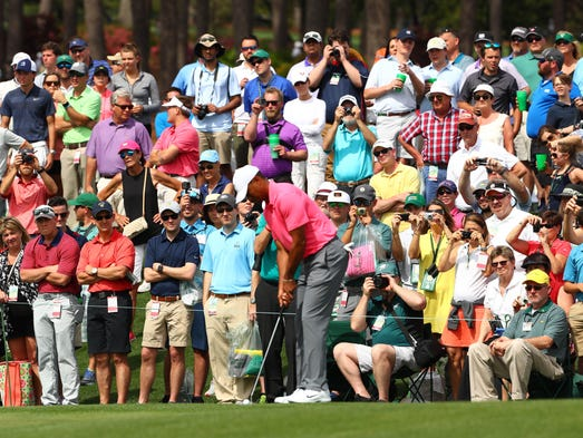 Patrons pack the hillside at the second green to watch