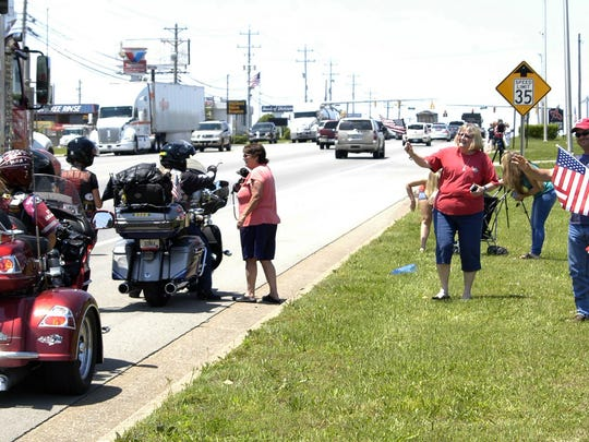 Riders with the Run for the Wall motorcade stop to greet bystanders along Highway 46 in front of Thunder Alley.