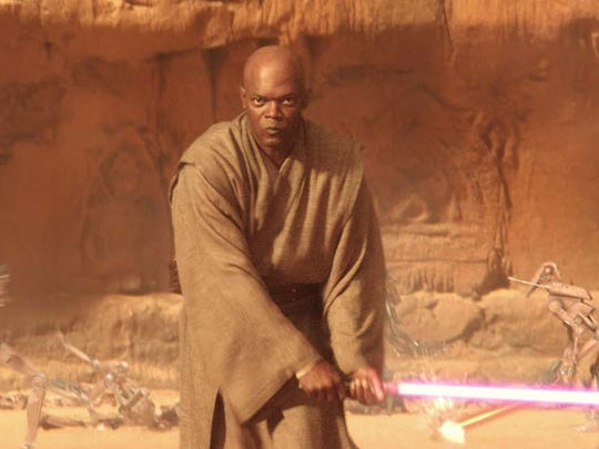 """Jedi master Mace Windu (Samuel L. Jackson) is about to slash up some folks with a lightsaber in """"Star Wars: Attack of the Clones."""""""