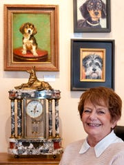 """Gail Bleiweiss, co-owner of the M. Phillips Gallery, was inspired to devote a show to dog portraits """"because it's always a dog show at the Farmers and Crafts Market outside my window,"""" she said."""