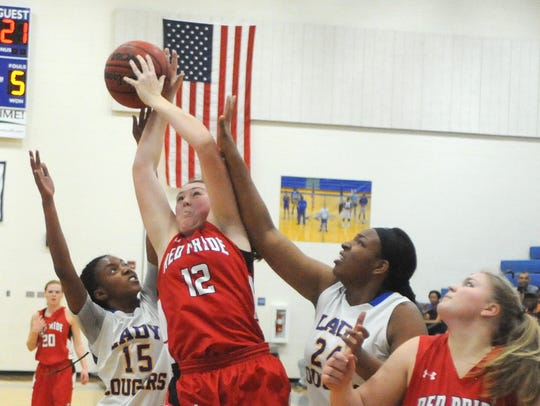Riverheads' Emma Casto (12) battles for a rebound Friday