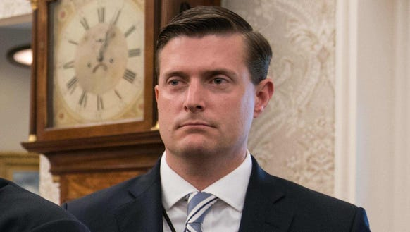 White House staff secretary Rob Porter looks on after