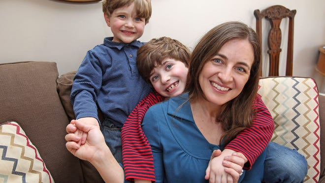 Emily Timmel and her two sons, Gabriel, 7, and Elliot, 5, who are being raised Jewish and Catholic, at home Wednesday in Croton-on-Hudson.