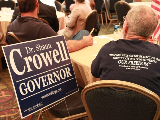 Party members picked up campaign signs at a Tennessee Constitution Party event Saturday at the DoubleTree Hotel.