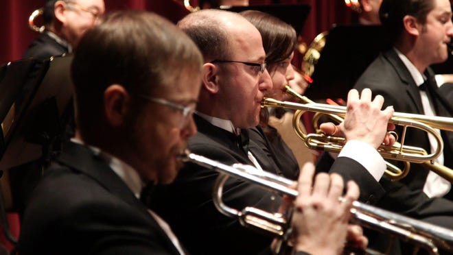 The brass section of the Salem Symphony plays at a concert.