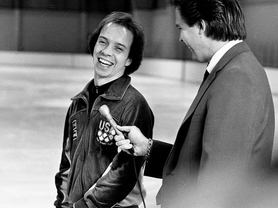 Scott Hamilton, the 1984 Olympic gold medal winner in men's figure skating, laughs with local TV reporter Bill Swanbeck at Ice Centennial skating rink in Nashville on Jan. 8, 1985.