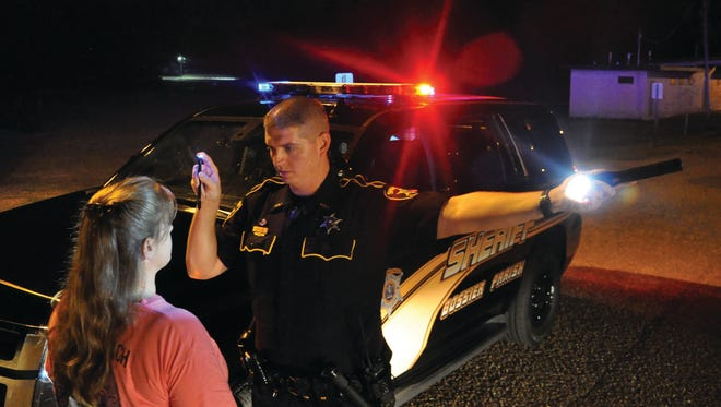 A Bossier Sheriff's deputy performs a sobriety check to check for impaired driving.