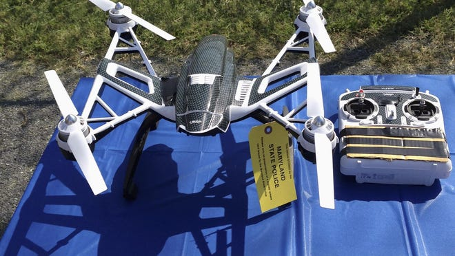 FILE - This Aug. 24, 2015, file photo shows a Yuneec Typhoon drone and controller in Jessup, Md.