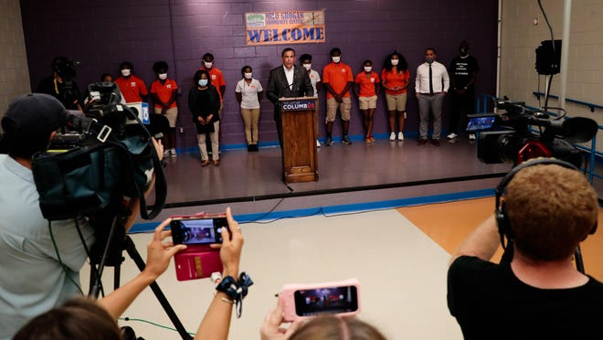 Columbus Mayor Andrew J. Ginther speaks during a news conference Saturday at Milo-Grogan Community Center to address a recent spike in violence in the city.