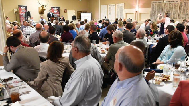 MIKE LAWRENCE / THE GLEANER Hosted by Kyndle, Rotary Club and the Breakfast Lions Club, Henderson County Judge-executive Brad Schneider delivers his first State of the County address before a packed house at the Henderson Elks Club Thursday, July 21, 2016.