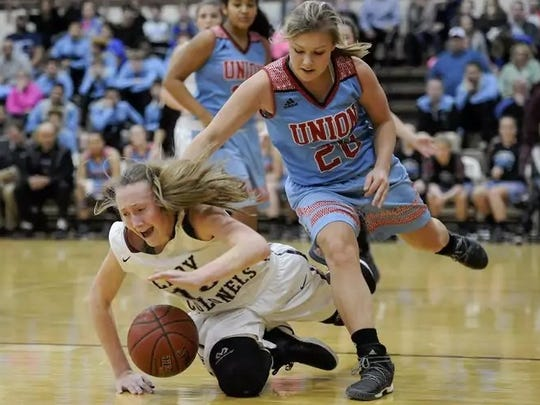 Union County's Alex Wright goes for a loose ball during the game against Henderson County last Tuesday night. The Bravettes fell to Henderson 74-37.