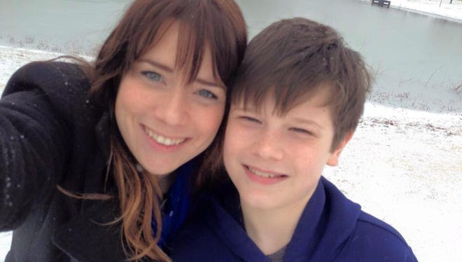 Good samaritans Kristi Clark and her son, Carter Oakley, 10, were killed Monday night as she tried to help passengers of an SUV involved in a crash on I-65 in Franklin.