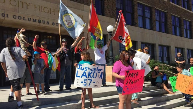 Tribal members rally for justice as a Philip man goes on trial in connection with a race-related incident in Rapid City in 2015. He was accused of spilling beer on Native American children at a Rapid City Rush hockey game.