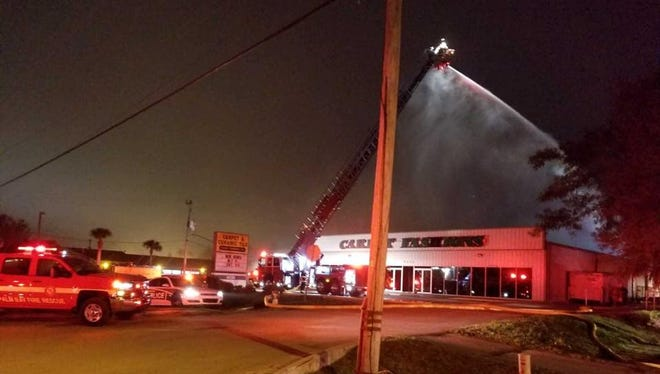 A fire heavily damage a Palm Bay carpet store Tuesday.