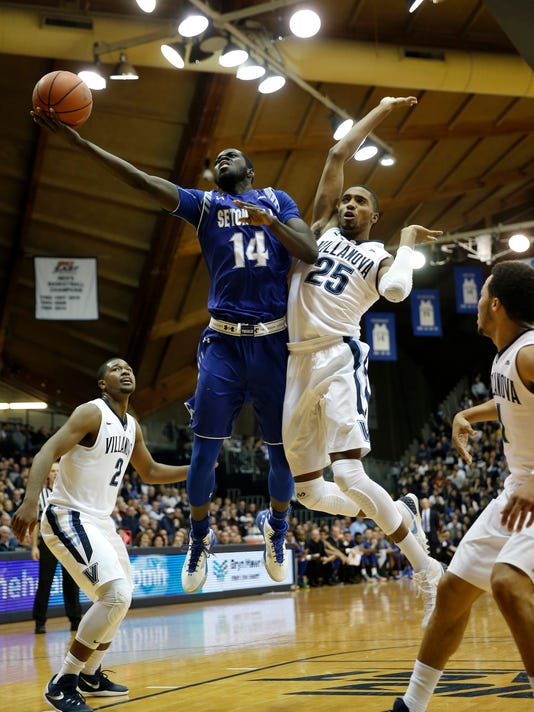 Seton Hall's Ismael Sanogo (14) goes up fro a shot against Villanova's Mikal Bridges (25) during the first half of an NCAA college basketball game, Wednesday, Jan. 6, 2016, in Villanova, Pa. (AP Photo/Matt Slocum)