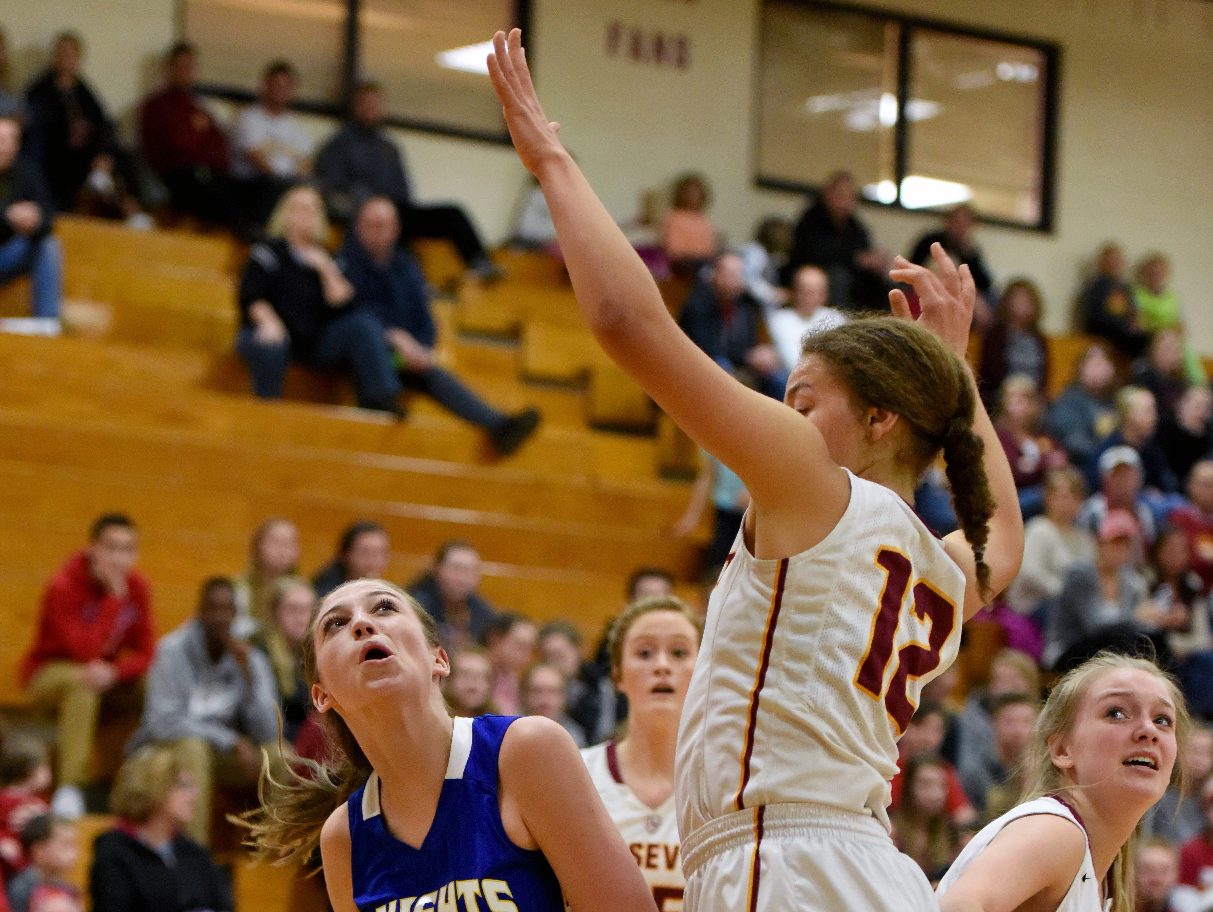 O'Gorman's Emma Ronsiek looks toward the basket while Roosevelt's Kira Ward guards during their game Thursday at Roosevelt High School.