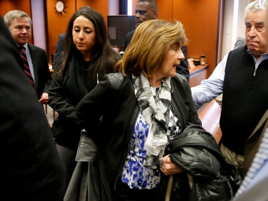From left to right, Essex County Assistant Prosecutor Brian Matthews looks on as Deanna Friedland and her mother Rose Fiedland, the sister and mother of murder victim Dustin Friedland, walk pass Essex County Sheriff Armando Fontoura as they prepare to leave the courtroom, Friday, March 31, 2017, in Newark, N.J.  moments after a jury found Basim Henry guilty on all counts for his role in the murder and carjacking of Dustin Friedland in December 2013 at an upscale New Jersey mall.