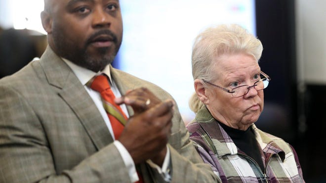 Linda Snow and her attorney Walter Madison are shown in Summit County Common Pleas Court in February. Snow was sentenced Thursday to four to six years in prison on charges related to her releasing pit bulls to attack an Acme employee after she stole groceries from the store.