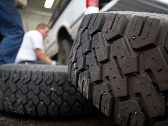 Studded tires wait to be installed on a pickup truck
